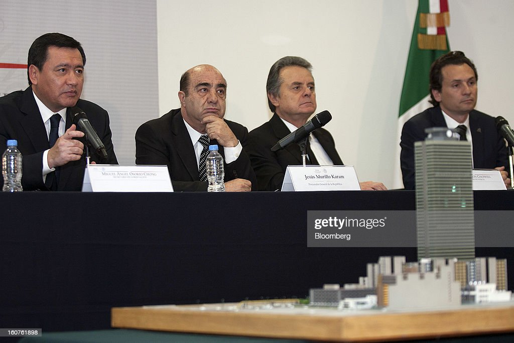 A model of the Petroleos Mexicanos (Pemex) administrative building sits in the foreground while Miguel Angel Osorio Chong, Mexico's minister of the interior, from left, Jesus Murillo Karam, Mexico's attorney general, Pedro Joaquin Coldwell, energy minister, and Emilio Lozoya Austin, chief executive officer of Pemex, hold a news conference in Mexico City, Mexico, on Monday, Feb. 4, 2013. The blast that killed 37 people at state-owned oil company Petroleos Mexicanos's headquarters in Mexico City last week was caused by gas buildup, Murillo said, the first government explanation for the nation's deadliest explosion since 2006. Photographer: Susana Gonzalez/Bloomberg via Getty Images