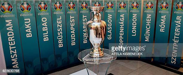 A model of the UEFA European football championship trophy is pictured surrounded with the names of host cities after an event to launch the...