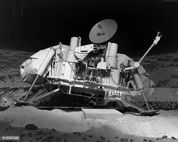 A model of the Viking 2 Lander on sand with a backdrop behind it painted to resemble Mars The Viking 2 Lander successfully landed on Mars in 1976