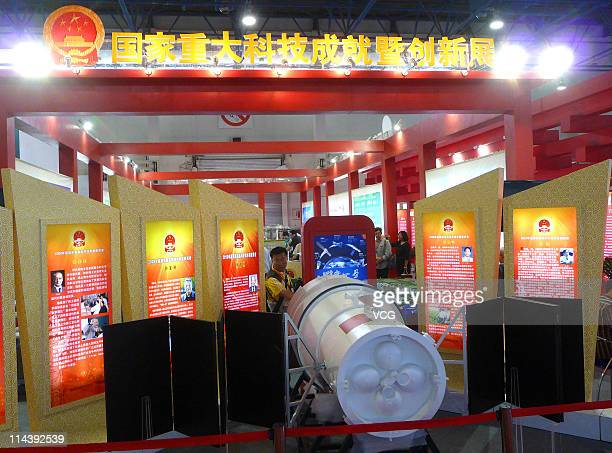 A model of unmanned space module Tiangong 1 is displayed during the 14th China Beijing International Hightech Expo at the China International...