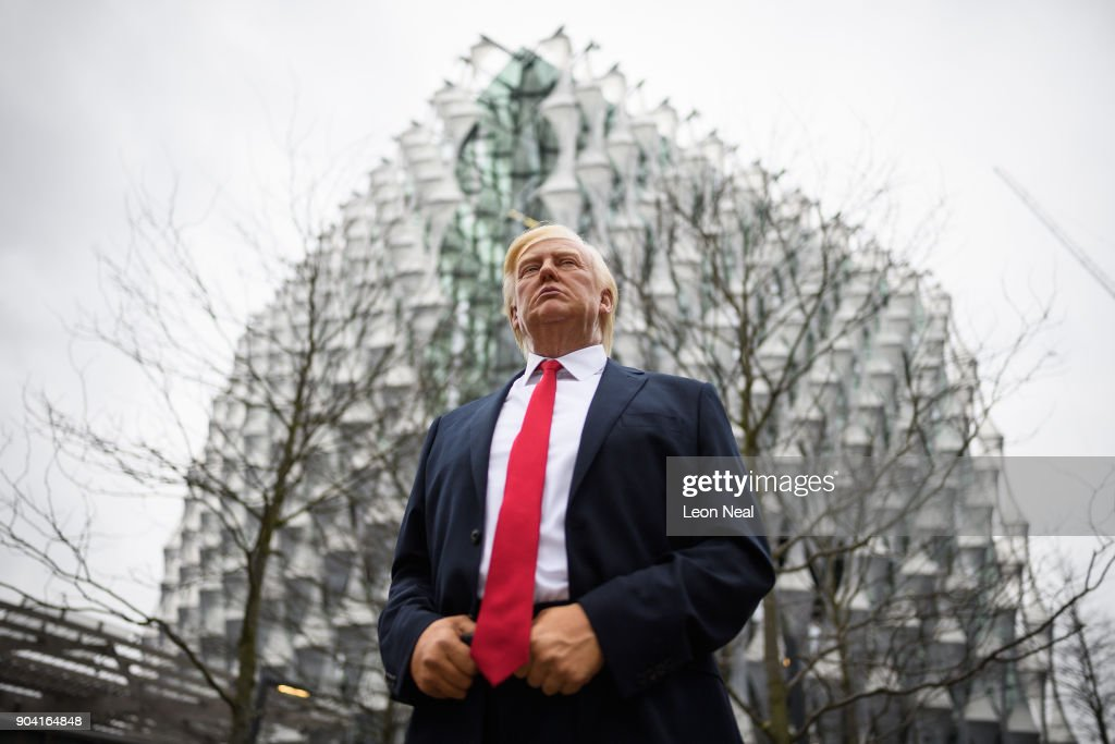 A model of US President Donald Trump from the Madame Tussaud's waxwork attraction is seen outside the new US embassy on January 12, 2018 in London, England. President Trump has tweeted that he will not go ahead with his planned visit to the new billion-dollar embassy, blaming previous President Barack Obama's 'bad' embassy deal as his reason for cancelling. Critics have speculated that Mr Trump could have been wary of protests and demonstrations if he chose to go ahead with his February visit.