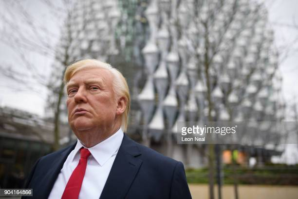 A model of US President Donald Trump from the Madame Tussaud's waxwork attraction is seen outside the new US embassy on January 12 2018 in London...