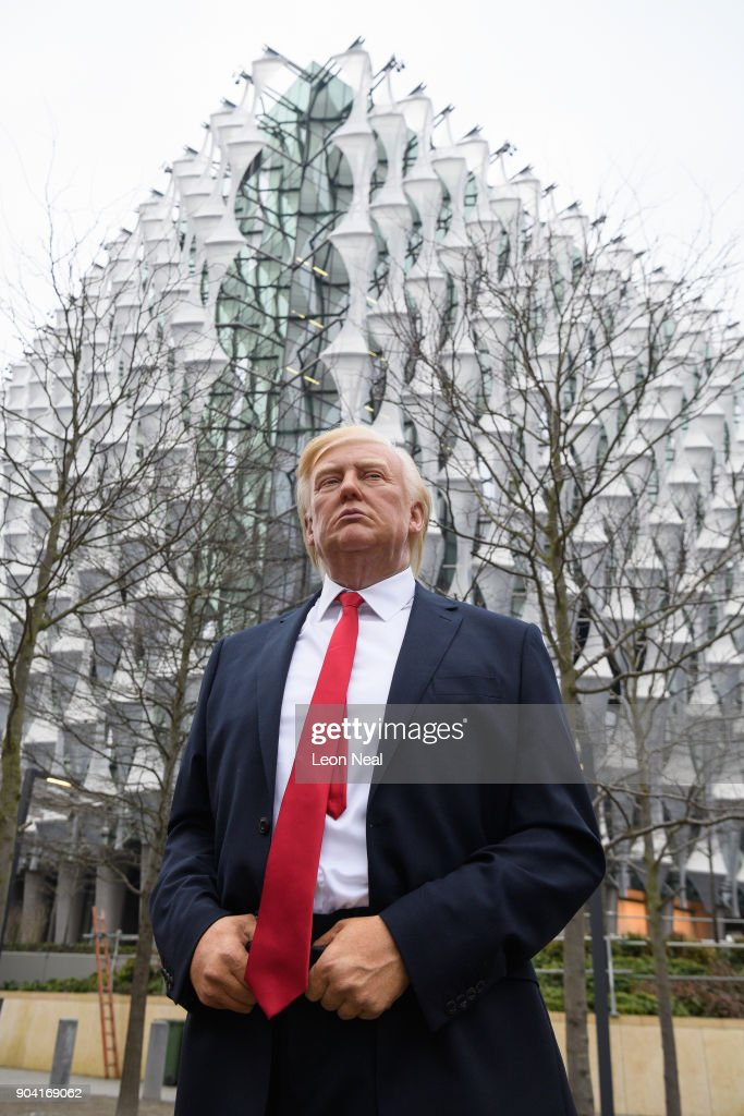 A model of US President Donald Trump from the Madame Tussaud's waxwork attraction stands outside the new US embassy on January 12, 2018 in London, England. President Trump has tweeted that he will not go ahead with his planned visit to the new billion-dollar embassy, blaming previous President Barack Obama's 'bad' embassy deal as his reason for cancelling. Critics have speculated that Mr Trump could have been wary of protests and demonstrations if he chose to go ahead with his February visit.