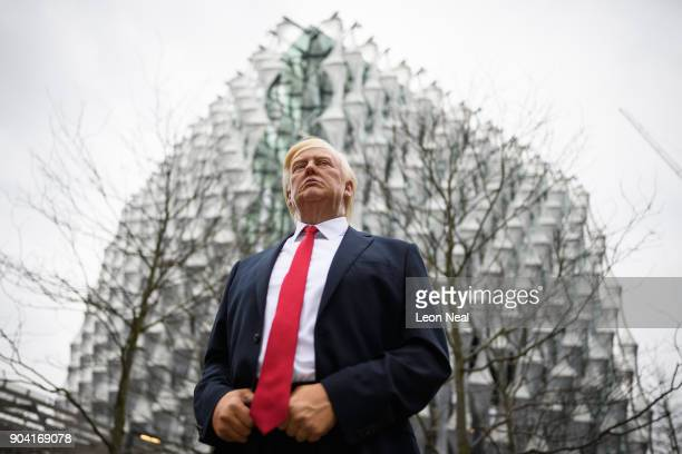 A model of US President Donald Trump from the Madame Tussaud's waxwork attraction stands outside the new US embassy on January 12 2018 in London...