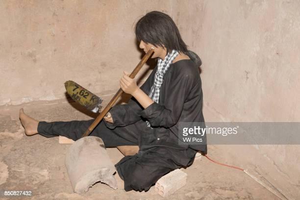 Model of Vietnamese person whittling Ben Dinh Cu Chi near Ho Chi Minh City Vietnam