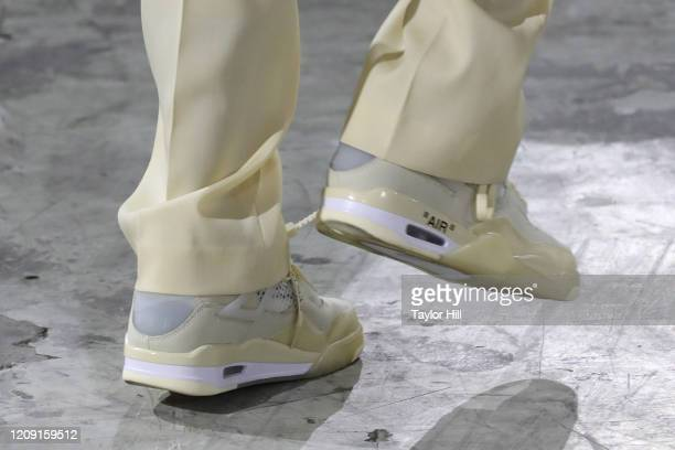 Model, Off-White Jordan 4 shoe detail, walks the runway during the Off-White show as part of the Paris Fashion Week Womenswear Fall/Winter 2020/2021...