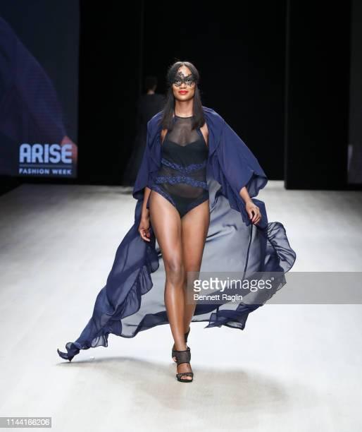 Model Ogy Okpe walks the runway wearing Lulu during Arise Fashion WeeK on April 20 2019 in Lagos Nigeria