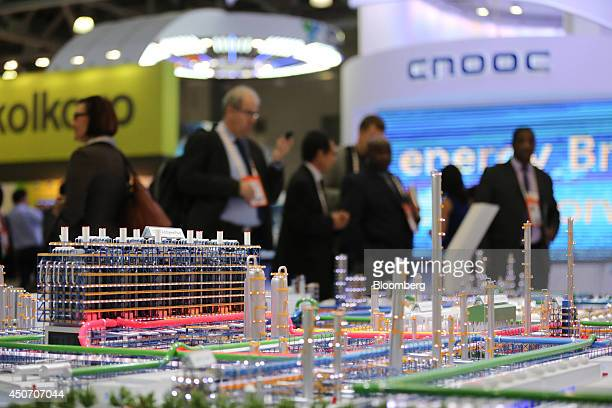 A model oil refinery stands on display at the China Petroleum Chemical Corp pavilion during the 21st World Petroleum Congress in Moscow Russia on...