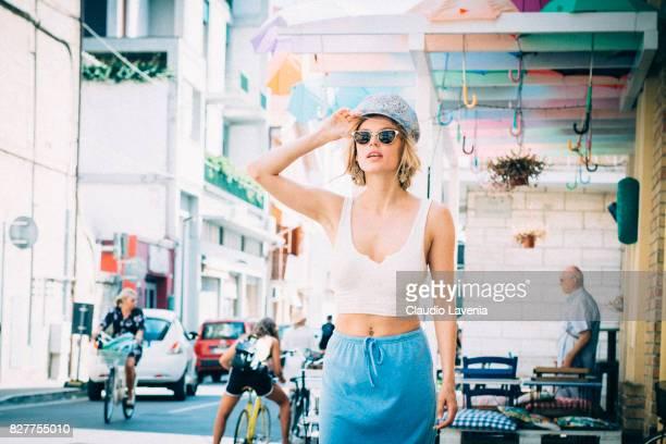 Model Olga de Mar wears Bershka earings and top Baldan shoes and vintage hat skirt and sunglasses on August 6 2017 in Porto San Giorgio Italy
