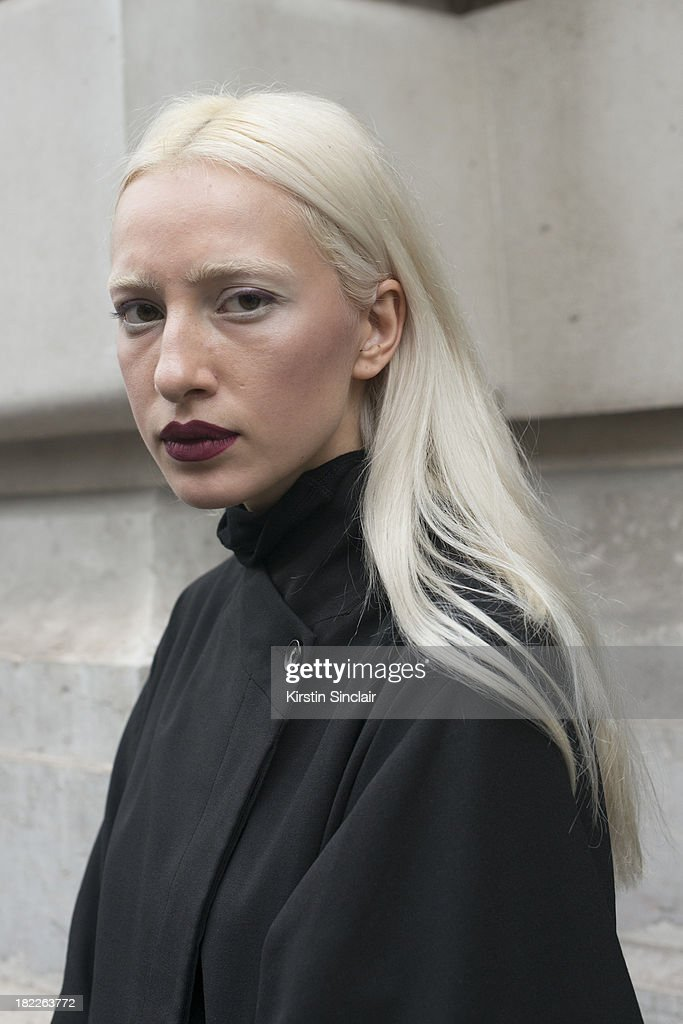 Model Olimpia Whitemustache wears a Malloni jacket and Poustovit dress on day 5 of Paris Fashion Week Spring/Summer 2014, Paris September 28, 2013 in Paris, France.