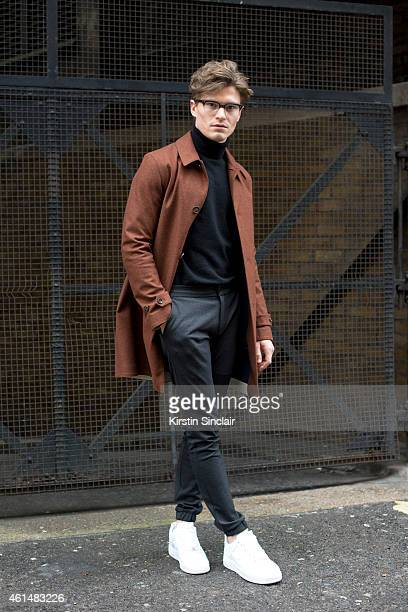 Model Oliver Cheshire wearing Nike Air Force One trainers Top Man Trousers  Marks and Spencers jumper
