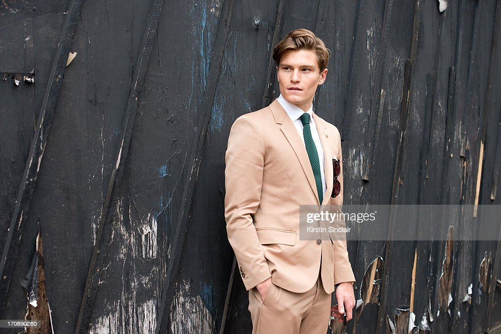 Model Oliver Cheshire wears a Martin Margiela suit, Reiss Shirt and Respect sunglasses on day 2 of London Collections: Men on June 17, 2013 in London, England.