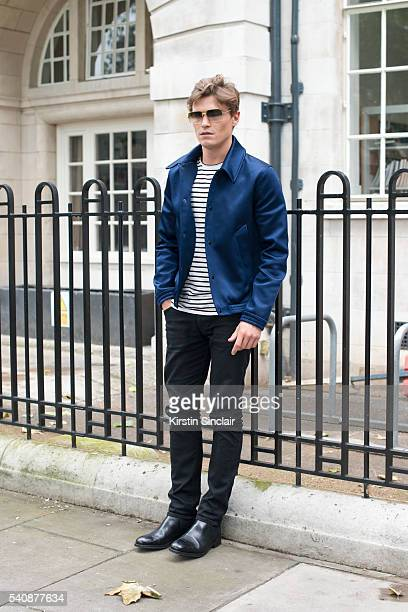 Model Oliver Cheshire wears an AMI jacket Villain T shirt Marks and Spencers boots and Topman jeans on day 4 of London Collections Men on June 13...