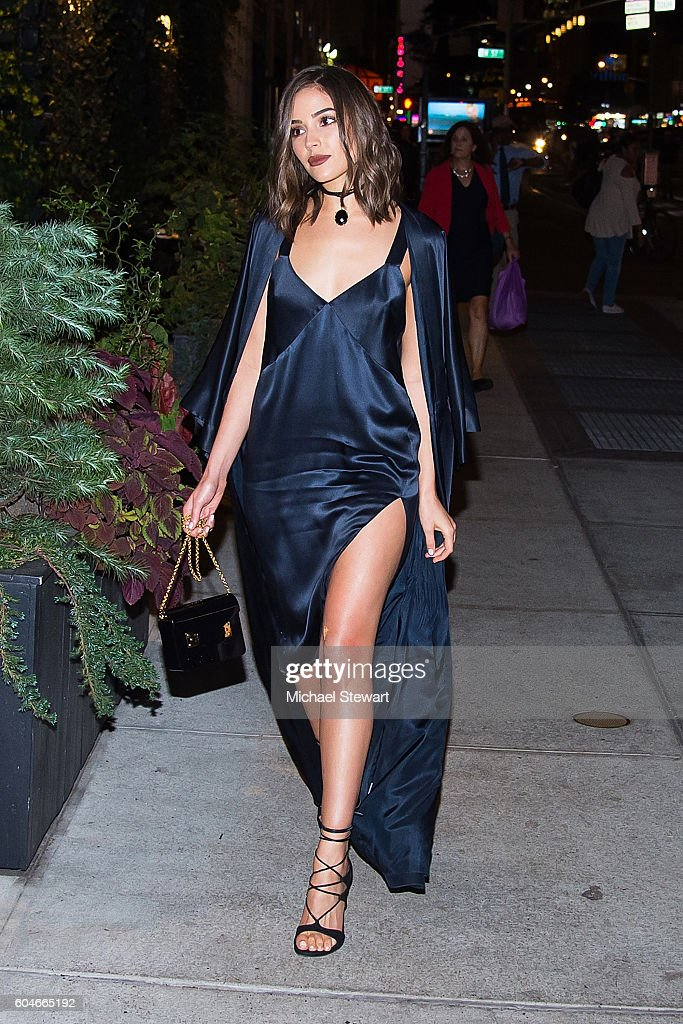 Model Olivia Culpo seen wearing a David Yurman mason dress and jacket, Stuart Weitzman shoes and a Sophie Hulme clutch in Midtown on September 13, 2016 in New York City.