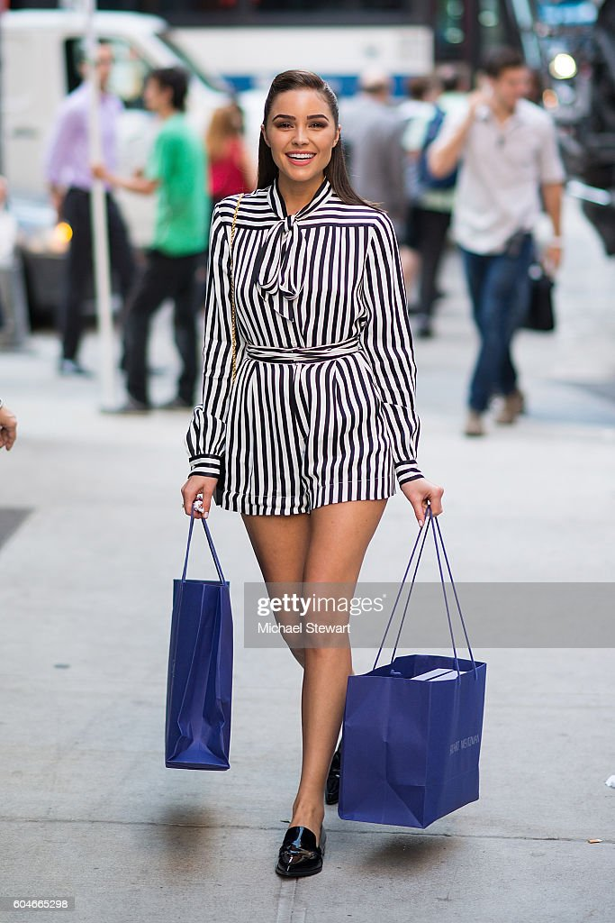 Model Olivia Culpo seen wearing a Philosophy dress, Stuart Weitzman shoes and a Sophie Hulme clutch in Midtown on September 13, 2016 in New York City.