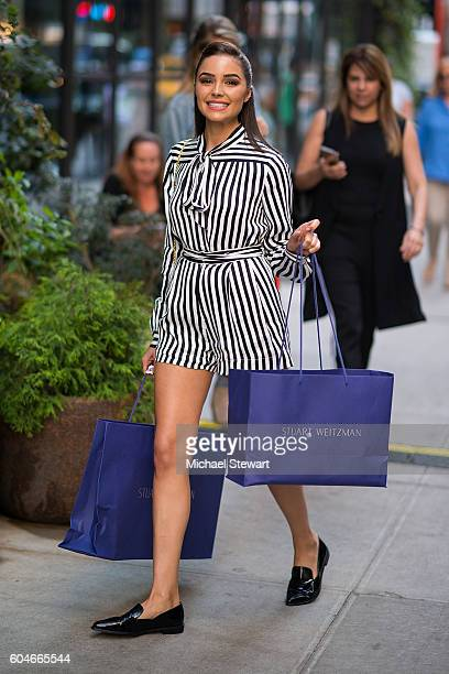 Model Olivia Culpo seen wearing a Philosophy dress Stuart Weitzman shoes and a Sophie Hulme clutch in Midtown on September 13 2016 in New York City