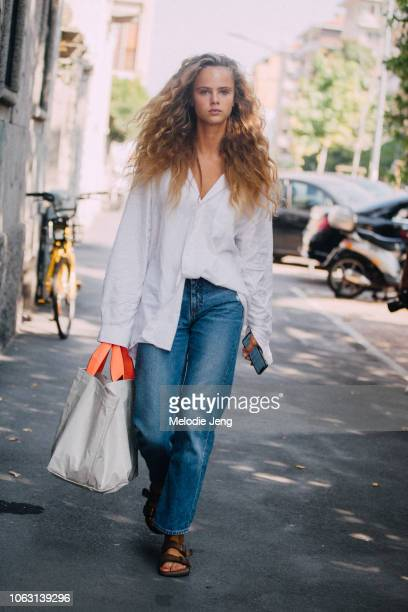 Model Olivia Vinten wears a white shirt blue jeans sandals and tote bag after the Etro show during Milan Fashion Week Spring/Summer 2019 on September...