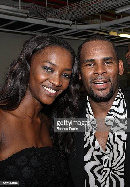 Model Oluchi and recording artist R. Kelly pose for a picture backstage at ARISE Africa Fashion Awards at Sandton Convention Center on June 20, 2009...