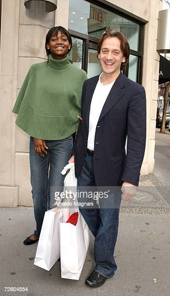 Model Oluchi Onweagba and designer Luca Orlandi pose in front of his store ''Luca Luca'' on Madison Avenue on November 19 2006 in New York City