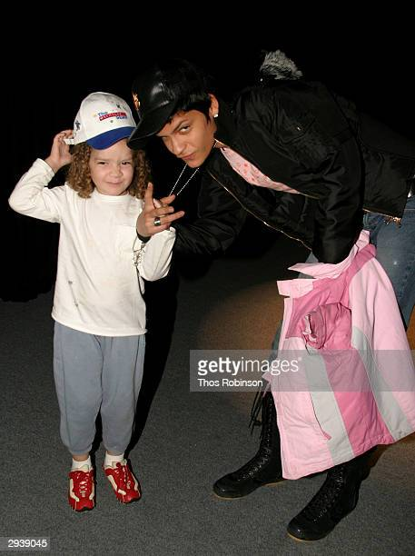 Model Omahyra Mota with her niece Tracy attend the Olympus Fashion Week in Bryant Park February 6 2004 New York City