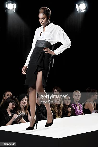 model on catwalk at fashion show - fashion show stock pictures, royalty-free photos & images