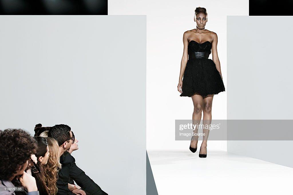 Model on catwalk at fashion show : Stock Photo