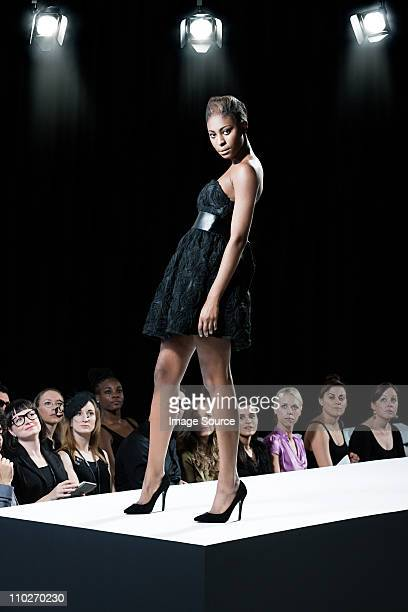 model on catwalk at fashion show - catwalk stock photos and pictures