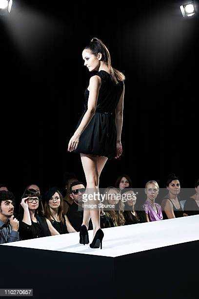model on catwalk at fashion show - fashion runway stock pictures, royalty-free photos & images