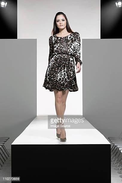 Model on catwalk at fashion show