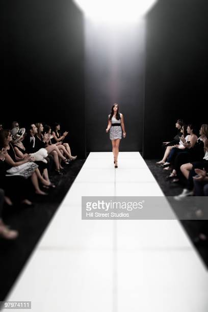 Model on runway at fashion show