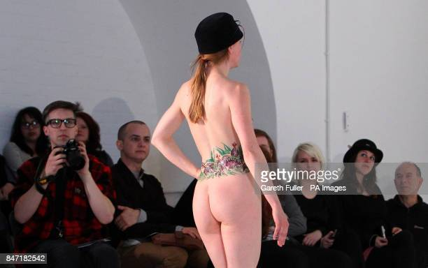 A model on the catwalk during a naked catwalk show by milliner Robyn Coles at The White Rabbit Studio in London