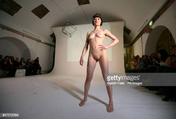 NOTE NUDITY***A model on the catwalk during a naked catwalk show by milliner Robyn Coles at The White Rabbit Studio in London
