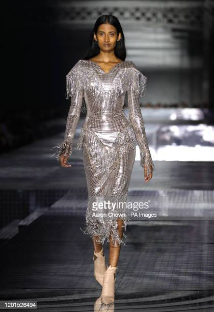 Model on the catwalk during the Burberry show at London Fashion Week February 2020, held at Olympia National, London.