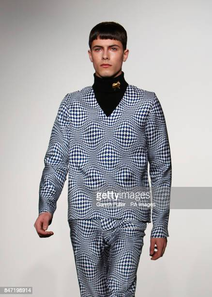 A model on the catwalk during the JW Anderson Men London Fashion Week show at St Martins College of Art and Design London