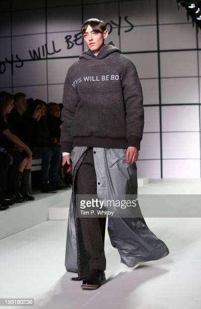 A model on the catwalk during the Xander Zhou show at the London Collections MEN AW13 at The Hospital Club on January 9 2013 in London England