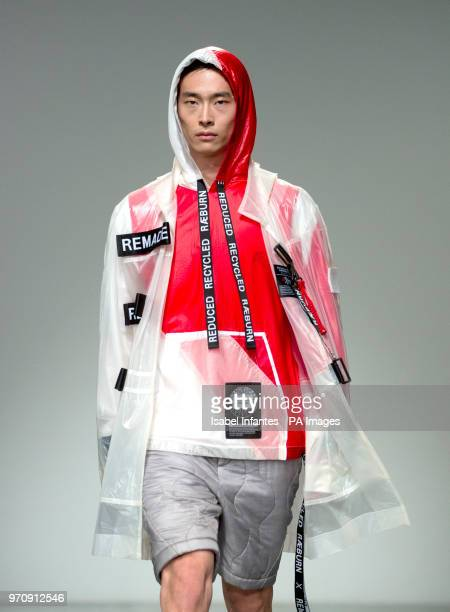 A model on the catwalk for the Christopher Raeburn show during London Fashion Week Men's SS19 show held at the BFC Show Space London