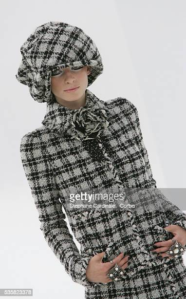 Model on the catwalk wearing a tweedlook suit and matching cap at the Chanel Fall/Winter 20042005 Haute Couture fashion show in Paris