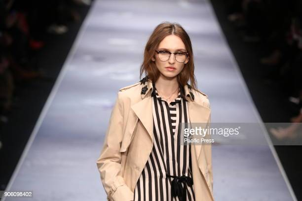 A model on the catwalk with the collection of the designer RIANI during MercedesBenz Fashion Week