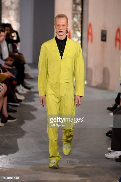 A model on the runway at the Kiko Kostadinov Presentation during the London Fashion Week Men's June 2017 collections on June 11 2017 in London England