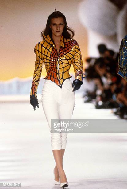 A model on the runway at the Thierry Mugler Spring 1989 fashion show circa 1988 in Paris France