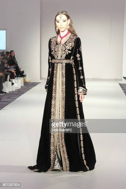 A model on the runway for Rafinity and Stories from Arabia during London Fashion Week February 2018 at Grand Connaught Rooms on February 19 2018 in...