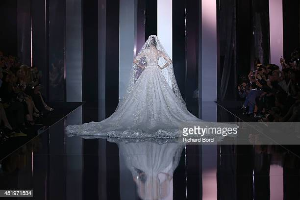 A model on the runway wearing a wedding dress to close the Ralph Russo show as part of Paris Fashion Week Haute Couture Fall/Winter 20142015 at...