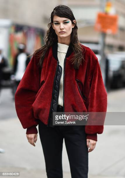 Model Ophelie Guillermand is seen wearing a red jacket black pants white sweater and teal eye liner outside of the ROCHAMBEAU show during New York...