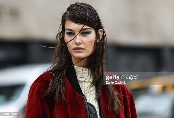 Model Ophelie Guillermand is seen wearing a red jacket white sweater and teal eye liner outside of the ROCHAMBEAU show during New York Fashion Week...