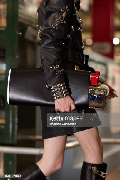 A model outfit detail walks the runway during Moschino Prefall 2020 Runway Show at New York Transit Museum on December 09 2019 in Brooklyn City