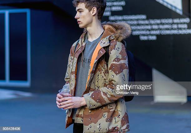 A model outside at No21 during Milan Men's Fashion Week Fall/Winter 2016/17 on January 17 in Milan Italy