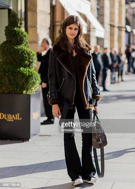 A model outside Schiaparelli during the Paris Fashion Week Haute Couture Spring/Summer 2016 on January 25 2016 in Paris France