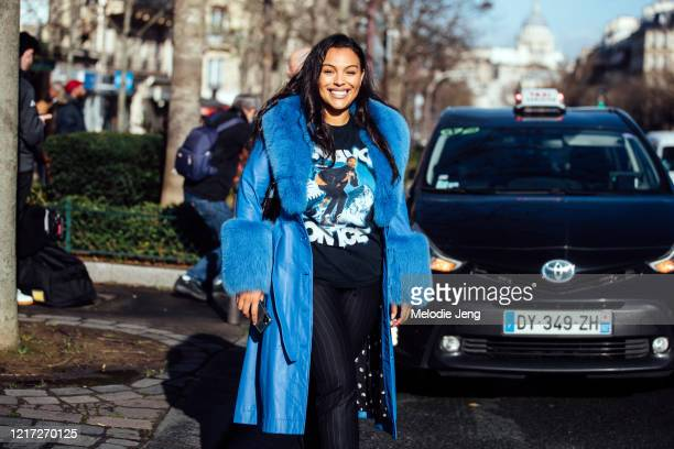Model Paloma Elsesser wears a blue Saks Potts coat with fur lining, black graphic t-shirt, and black pants after the Lanvin show during Paris Fashion...