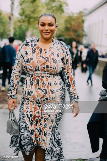 Model Paloma Elsesser wears a silver earring and printed dress after the Mugler show during Paris Fashion Week Spring/Summer 2020 on September 25,...
