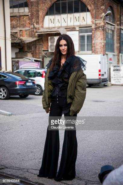 Model Paola Turani wearing a black space style concept shirt is seen outside Missoni show during Milan Fashion Week Fall/Winter 2018/19 on February...